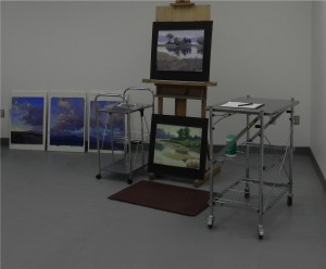 Easel and carts with Taos and Sepowet paintings