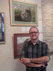 Philippe Caille (aka Pastel Philippe) with his cat painting